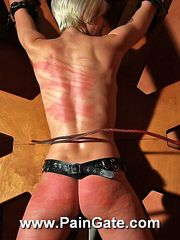 Juicy nude blonde is fixed to the whipping wheel and lashed all over her hot body.