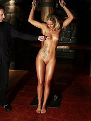 Tied up blonde cutie with oiled skin gets lashed brutally in the dark dungeon.