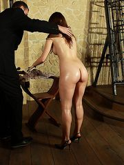 Hot painslave Lola loves to be punished with whips and canes on her oiled skin the ultra hard way.