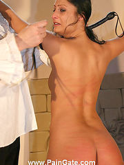 Brunette maid in painful coach whip trashing for bad service. See her suffer naked in chains.