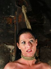 Strangled and with her hands bound behind her back the cutie has to endure her personal whipping nightmare.