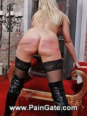 No mercy is given for juicy nude busty blonde whipping slavegirl.