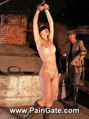 Blindfolded and hanged up russian beauty gets lashed brutally in dark dungeon.