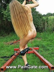 Innocent blonde beauty gets tortured outdoor by stinging lashes the very first time.