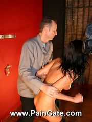 Skinny brunette is tied up for an outstanding breast and pussy whipping tourture on the wall.