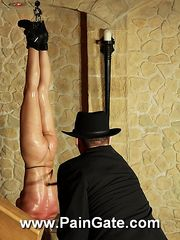 Blonde nude slavegirl is hanged upside down to her feets and lashed by the most brutal way.