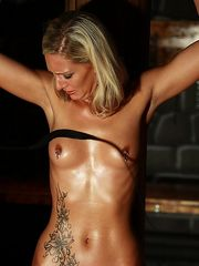 Tied up blonde cutie with oiled skin gets lashed brutally in the dark dungeon